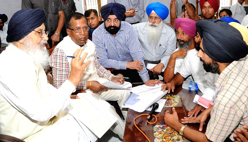 Punjab Chief Minister Parkash Singh Badal interacts with people during Sangat Darshan in Phagwara of Punjab on June 14, 2015. - Parkash Singh Badal