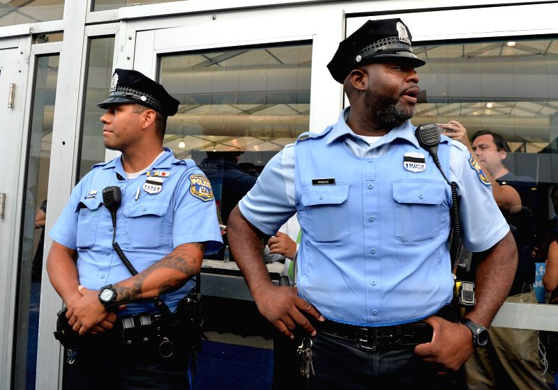 PHILADELPHIA, July 27, 2016 - Police officers stand on guard at the Media Pavilion of Wells Fargo Center, in Philadelphia, Pennsylvania, the United States, July 26, 2016.