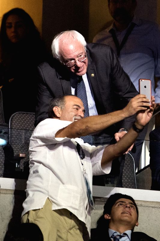 PHILADELPHIA, July 27, 2016 - Senator Bernie Sanders (Upper) of Vermont poses for a photo with a delegate on the second day of the 2016 Democratic National Convention in Philadelphia, Pennsylvania, ...