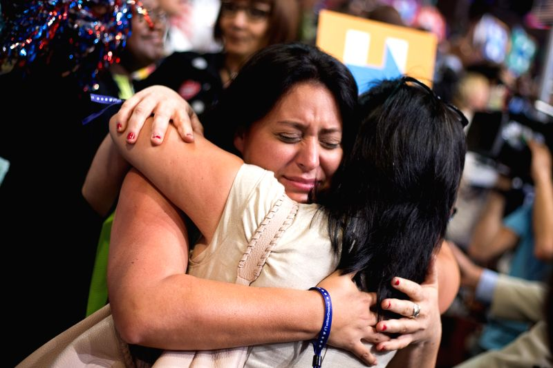 PHILADELPHIA, July 27, 2016 - Women react after Hillary Clinton was formally anointed Democratic presidential candidate on the second day of the 2016 U.S. Democratic National Convention in ...