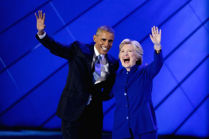 PHILADELPHIA, July 28, 2016 - U.S. Democratic Presidential Candidate Hillary Clinton (R) and U.S. President Barack Obama are pictured on the third day of the 2016 Democratic National Convention in ...