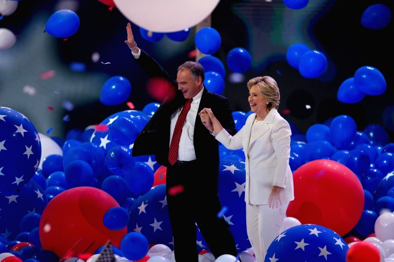 PHILADELPHIA, July 29, 2016 - U.S. Democratic presidential nominee Hillary Clinton(R) and her running mate Democratic vice presidential nominee Tim Kaine gesture on the stage on the last day of the ...