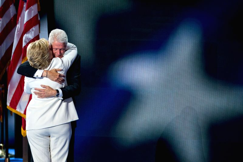 PHILADELPHIA, July 29, 2016 - U.S. Democratic presidential nominee Hillary Clinton (L) embraces her husband former U.S. President Bill Clinton on the last day of the 2016 U.S. Democratic National ...