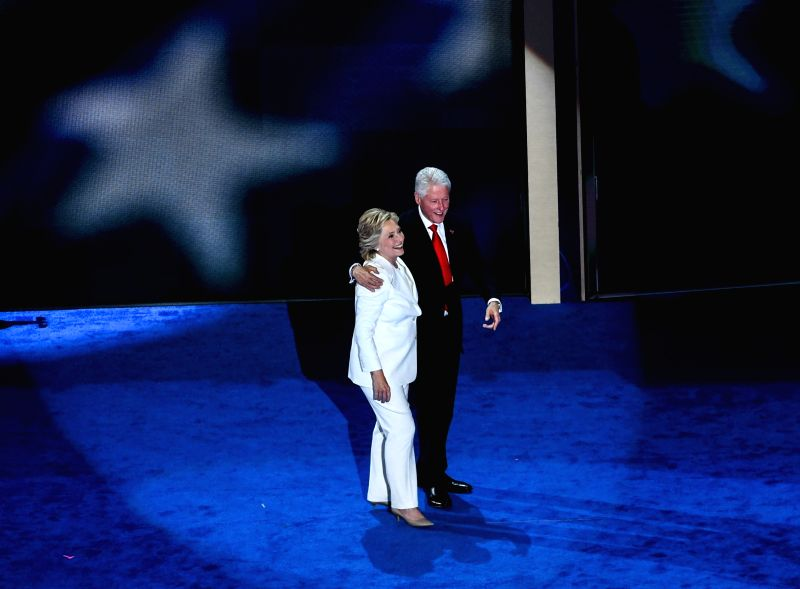 PHILADELPHIA, July 29, 2016 - U.S. Democratic Nominee for President Hillary Clinton (L) and her husband, U.S. former president Bill Clinton take the stage on the last day of the 2016 Democratic ...
