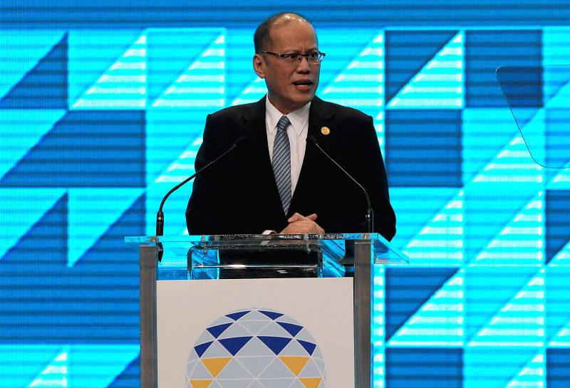 Philippine President Benigno Aquino III addresses the press conference at the close of the 23rd APEC Economic Leaders' Meeting in Manila, the Philippines, Nov. 19, ...
