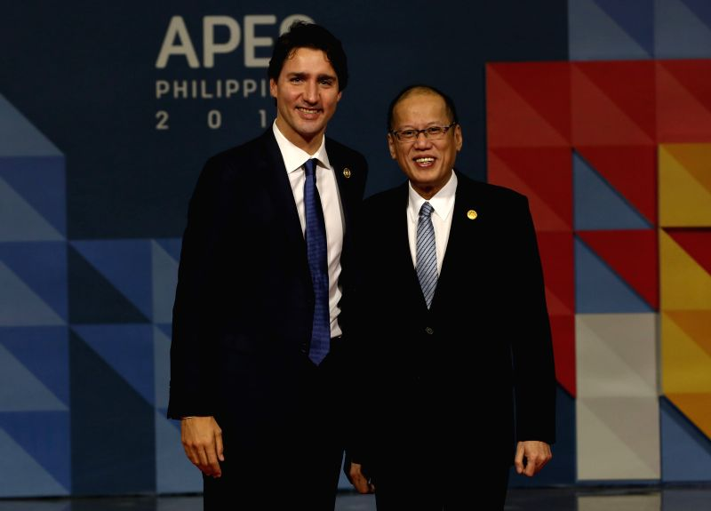 Philippine President Benigno Aquino III (R) poses for a photo with Canadian Prime Minister Justin Trudeau before the start of the 23rd APEC Economic Leaders' Meeting ... - Justin Trudeau