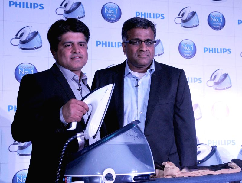 Philips India Consumer Lifestyle President ADA Ratnam and Director Marketing Gulbahar Taurani launch 'perfectCare Iron' in New Delhi on Aug 27, 2014.
