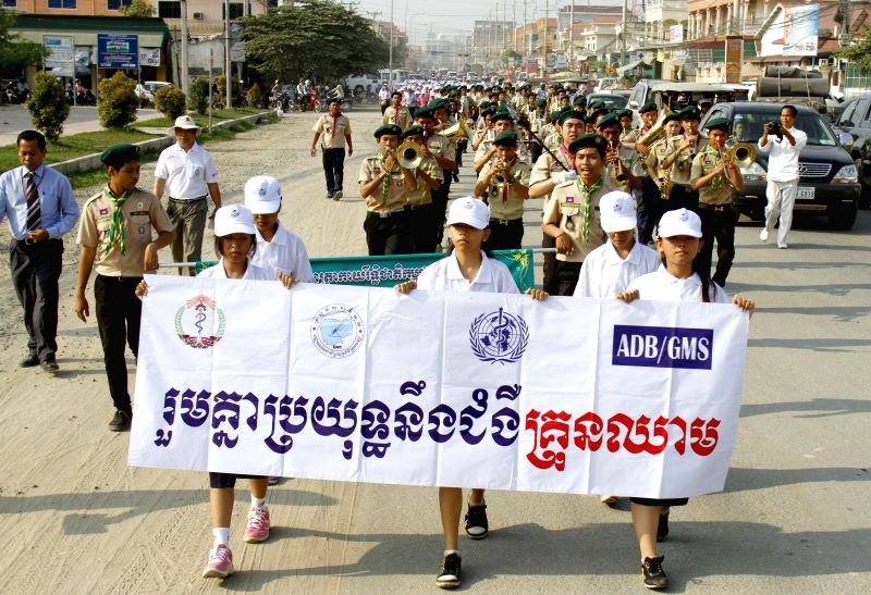 People march on streets to mark an annual campaign against dengue fever in Phnom Penh, Cambodia, April 24, 2014. Cambodia on Thursday commenced its annual ...