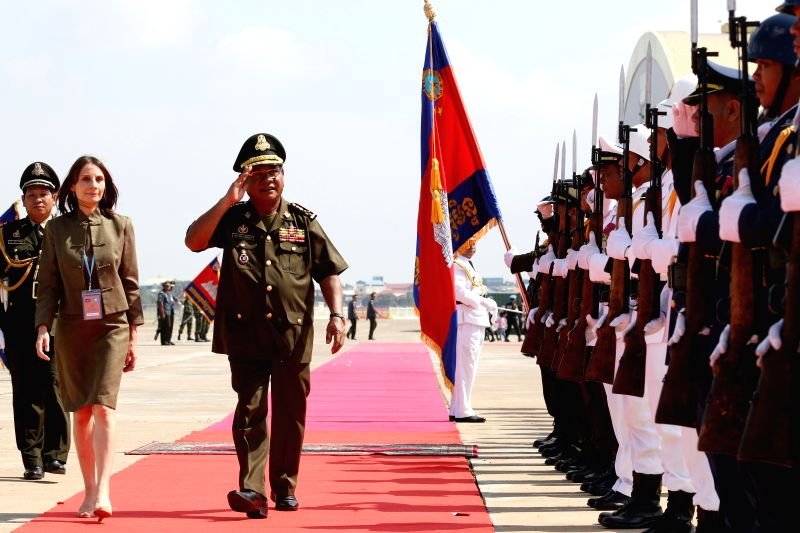 PHNOM PENH, April 25, 2017 - Gen. Pol Saroeun (3rd L), Commander-In-Chief of the Royal Cambodian Armed Forces (RCAF), and Debora Comini (2rd L), United Nations Resident coordinator, inspect the guard ...
