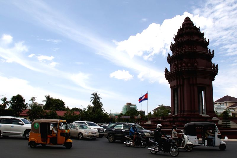 PHNOM PENH, Aug. 1, 2018 - Vehicles run past the Independence Monument in Phnom Penh, Cambodia, on July 31, 2018. Life and business activities have returned to normalcy in Cambodia after the general ...