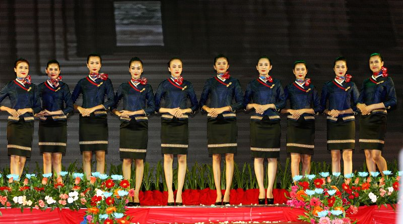 Flight attendants of Cambodia Bayon Airlines show hospitality during the launching ceremony of the Cambodia Bayon Airlines in Phnom Penh, Cambodia, Aug. 21, ...