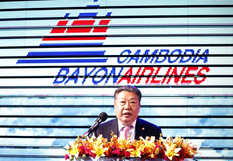 Lin Zuoming, chairman of the Aviation Industry Corporation of China, speaks on the lauching ceremony in Phnom Penh, Cambodia, Aug. 21, 2014. Cambodia Bayon ...