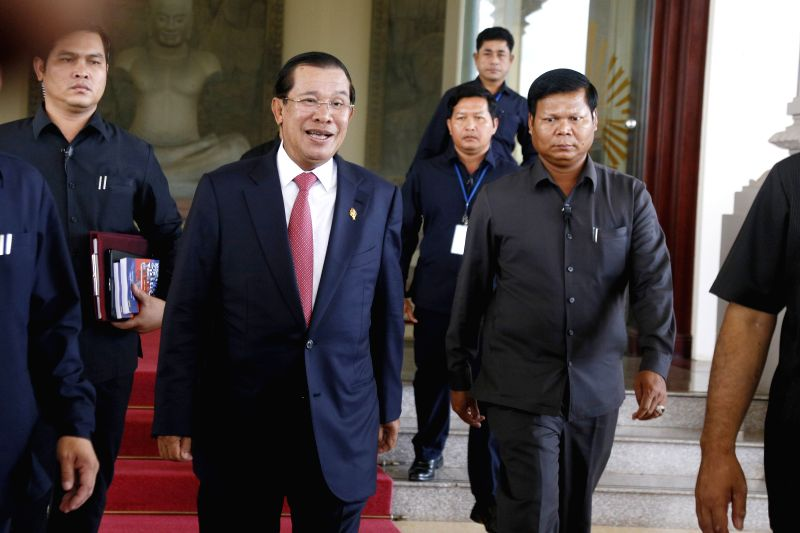 PHNOM PENH, Aug. 26 2014 Cambodian Prime Minister Hun Sen (C) emerges from the parliamentary session on Aug. 26, 2014 in Phnom Penh, Cambodia. 122 of the 123 lawmakers from the ruling and