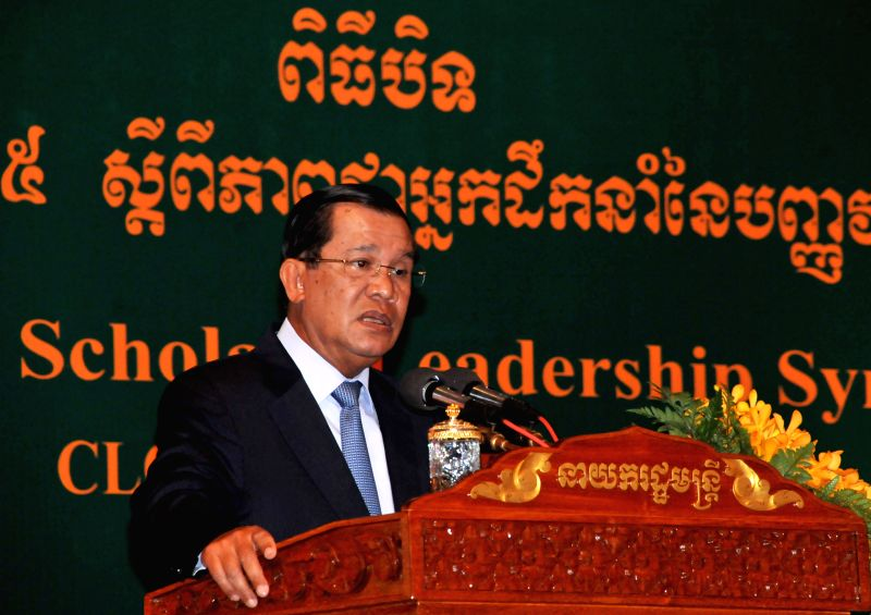 Cambodian Prime Minister Hun Sen speaks at a university scholars symposium in Phnom Penh, Cambodia, Aug. 6, 2014. Cambodian Prime Minister Hun Sen said Wednesday .