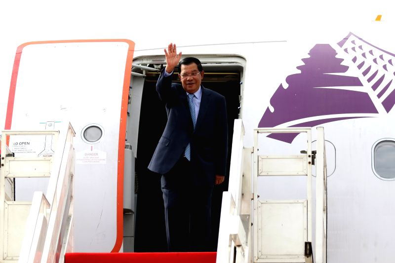 PHNOM PENH, Aug. 6, 2016 - Cambodian Prime Minister Samdech Techo Hun Sen gestures from a plane in Phnom Penh, Cambodia, Aug. 6, 2016. Cambodian Prime Minister Samdech Techo Hun Sen left here on ... - Samdech Techo Hun Sen
