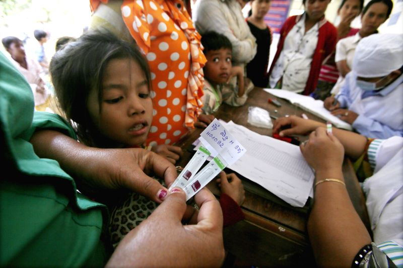 People flock to have their blood tested for HIV in Roka commune of northwest Cambodia's Battambang province, on Dec. 18, 2014. The Cambodian health ministry, ...