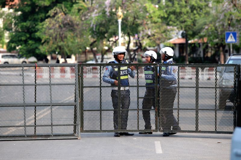 PHNOM PENH, Feb. 1, 2018 - Cambodian traffic policemen block a road leading to the Appeal Court in Phnom Penh, Cambodia, on Feb. 1, 2018. The Appeal Court of Cambodia on Thursday rejected an ...