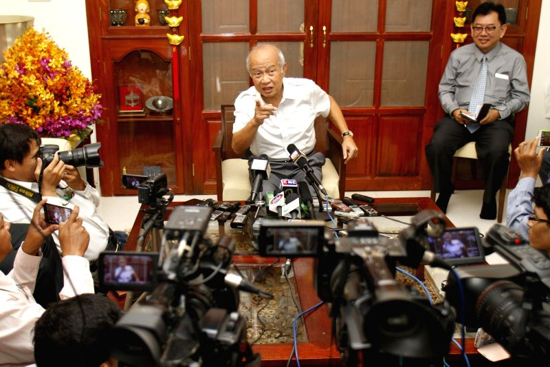 Cambodian Prince Norodom Ranariddh (C), a son of late King Norodom Sihanouk, speaks on a press conference in Phnom Penh, Cambodia, Jan. 5, 2015. Ranariddh said ... - Hun S