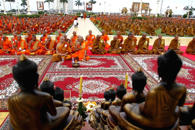 Buddhist monks chant prayers in front of the Royal Palace in Phnom Penh, Cambodia, July 10, 2014. Cambodia on Thursday began a three-day elaborate ceremony to ...