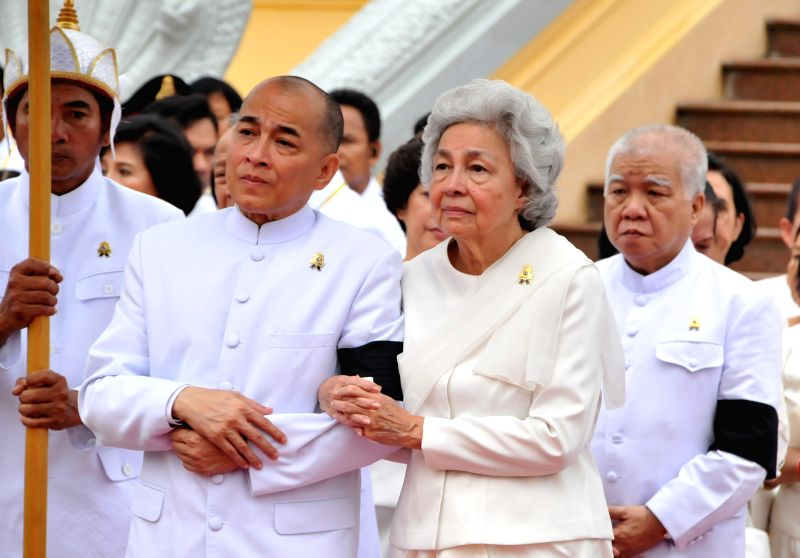 Queen Mother Norodom Monineath (R, front), wife of Cambodia's late King Father Norodom Sihanouk, and her son, current King Norodom Sihamoni (L, front), attend ...