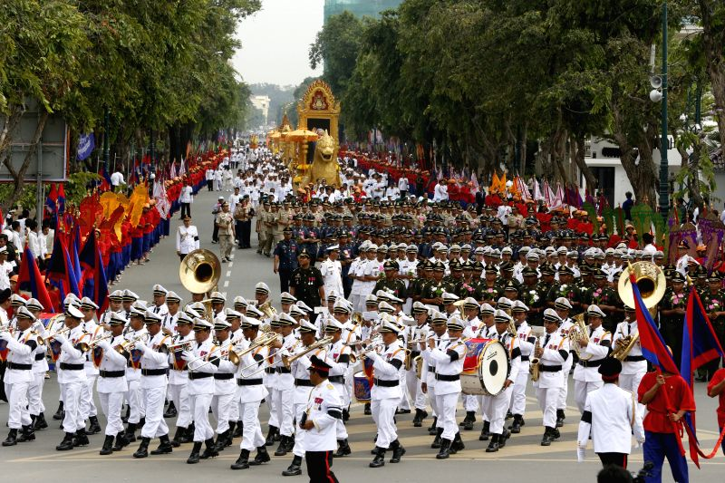 The late Cambodian King Sihanouk's remains are marched through streets in Phnom Penh, Cambodia, July 11, 2014. Thousands of people attended a religious ...