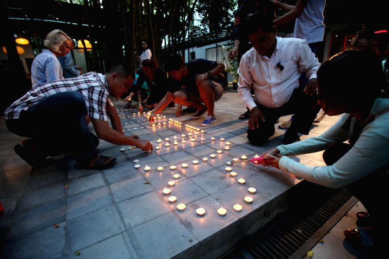 PHNOM PENH, July 15, 2016 - People attend a candle-light vigil in memory of the victims of the Nice attack in Phnom Penh, Cambodia, July 15, 2016. The National Assembly of Cambodia issued a statement ...