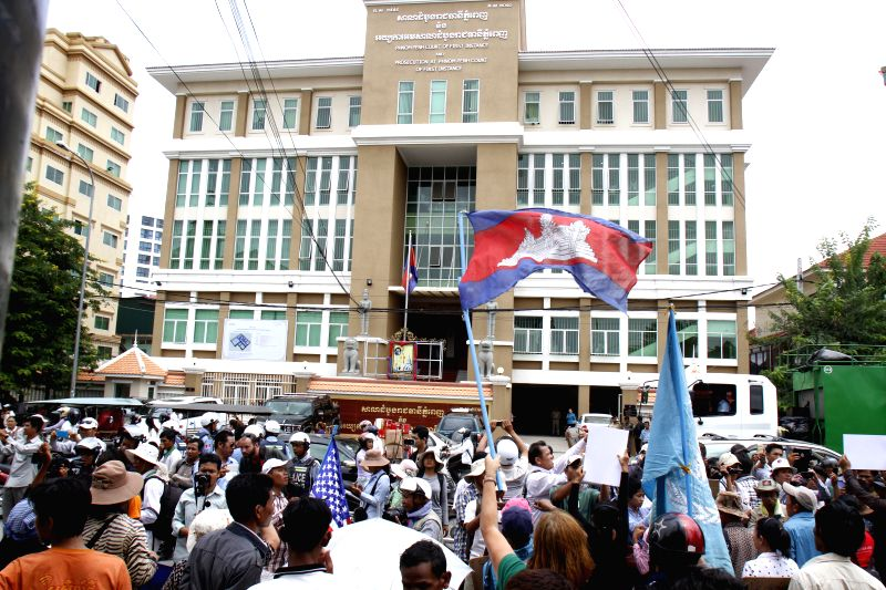Cambodian opposition supporters gather in front of the Phnom Penh Municipal Court to demand the release of eight opposition politicians in Phnom Penh, Cambodia, .