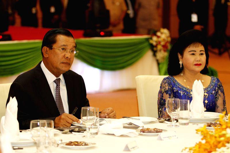 Cambodian Prime Minister Hun Sen (L) and his wife Bun Rany attend a Ramadan Iftar Dinner in Phnom Penh, Cambodia, July 18, 2014. Cambodian Prime Minister Hun Sen - Hun Sen