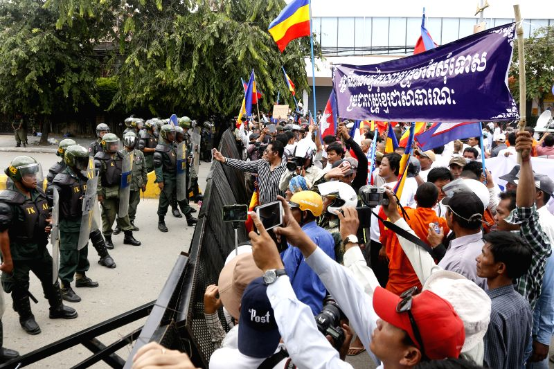 Cambodian anti-riot police safeguard the Vietnamese Embassy in Phnom Penh, Cambodia, July 21, 2014. Approximately 800 ethnic minority Khmer Krom monks and ...