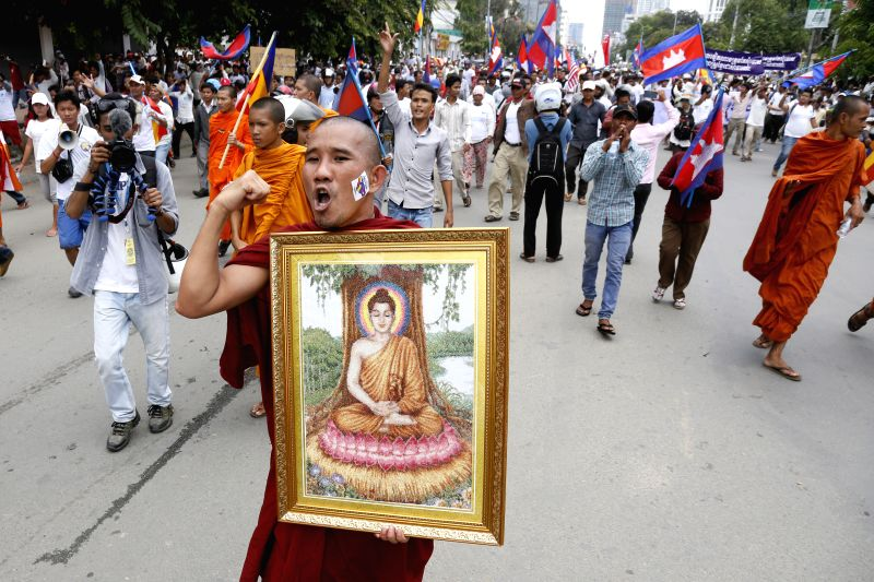 Protesters march through streets in Phnom Penh, Cambodia, July 21, 2014. Approximately 800 ethnic minority Khmer Krom monks and activists on Monday marched ...