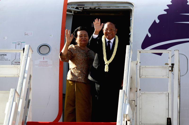 PHNOM PENH, July 25, 2016 - Cambodia's National Assembly President Samdech Heng Samrin (R) and his wife gesture from a plane in Phnom Penh, Cambodia, July 25, 2016. Cambodia's National Assembly ...