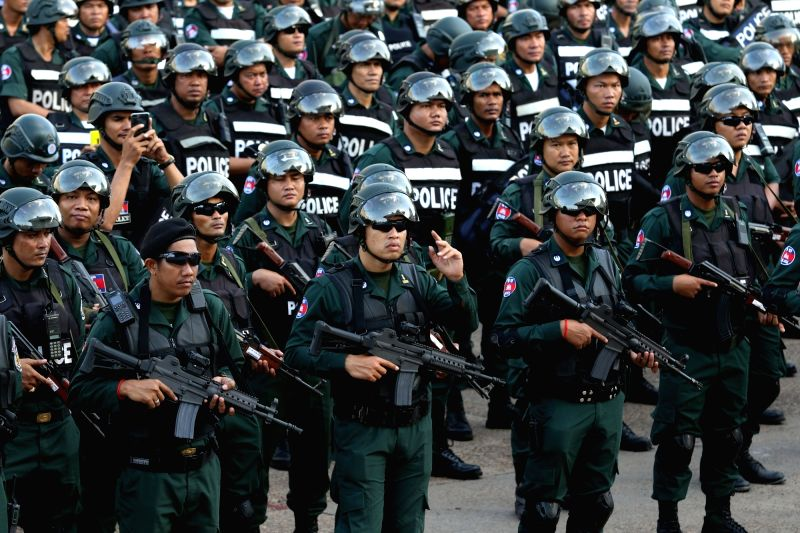 PHNOM PENH, July 25, 2018 - Police security forces gather in Phnom Penh, Cambodia, on July 25, 2018. Nearly 70,000 security personnel will be deployed at all 22,967 polling stations during Cambodia's ...