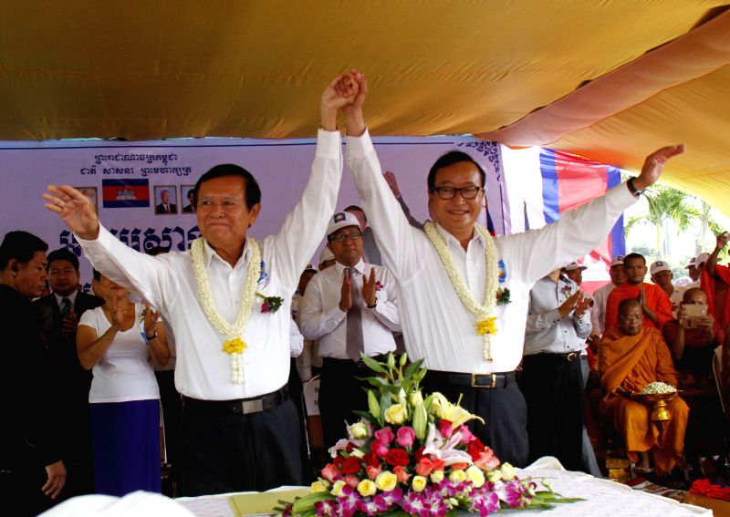Sam Rainsy (R), president of the opposition Cambodia National Rescue Party (CNRP), and his deputy Kem Sokha gesture in Phnom Penh, Cambodia, July 27, 2014. The ..