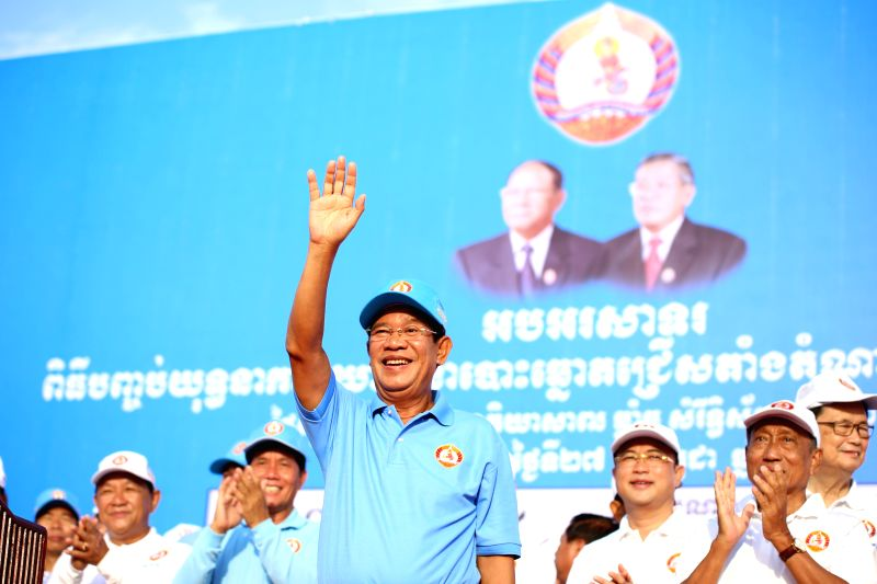 PHNOM PENH, July 27, 2018 - Cambodian Prime Minister Samdech Techo Hun Sen (Front) waves to supporters during a massive rally of the ruling Cambodian People's Party (CPP) in Phnom Penh July 27, 2018. ... - Samdech Techo Hun Sen