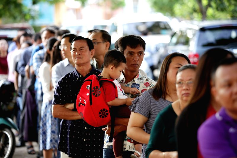 PHNOM PENH, July 29, 2018 - Voters queue to vote at a polling station in Phnom Penh, Cambodia, on July 29, 2018. The sixth general election kicked off in Cambodia on Sunday with a total of 20 ...