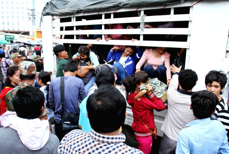 Cambodian migrant workers disembark from a truck in Poipet City, Cambodia, June 18, 2014. Over 200,000 Cambodian migrant laborers, mostly illegal workers, have ..