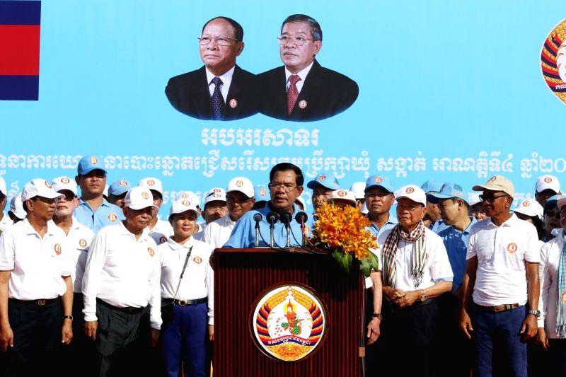 PHNOM PENH, June 2, 2017 - Cambodian Prime Minister Samdech Techo Hun Sen speaks during an election campaign in Phnom Penh June 2, 2017. The Cambodian People's Party held an election campaign parade ... - Samdech Techo Hun Sen