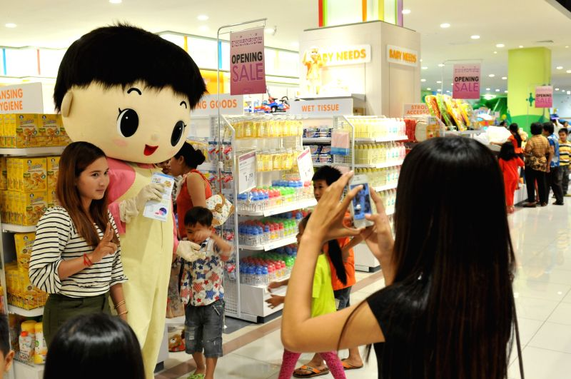 People take photos at AEON Mall in Phnom Penh, Cambodia, June 24, 2014. The Japanese-invested shopping mall is currently Cambodia's largest modern mall, which is - Hun Sen