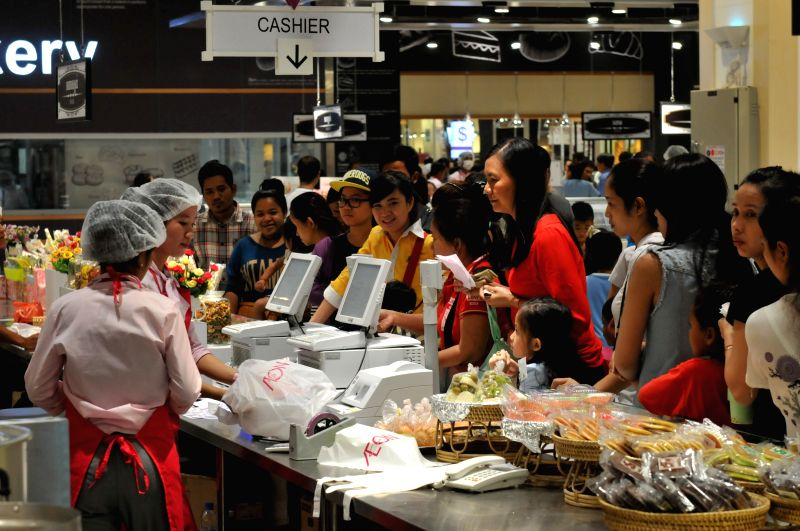 Throngs of people do shopping at AEON Mall in Phnom Penh, Cambodia, June 24, 2014. The Japanese-invested shopping mall is currently Cambodia's largest modern ... - Hun Sen