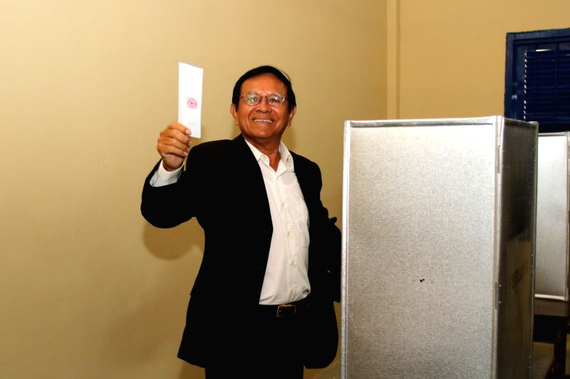 PHNOM PENH, June 4, 2017 - Kem Sokha, president of the opposition Cambodia National Rescue Party (CNRP), shows his ballot-paper in Phnom Penh, Cambodia, on June 4, 2017. The commune elections kicked ...