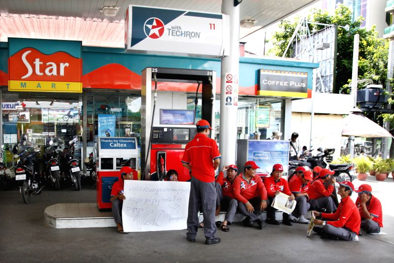 Cambodian employees attend a strike at a Caltex petrol station in Phnom Penh, Cambodia, May 12, 2014. Hundreds of Cambodian staff employed by the U.S.-owned ...