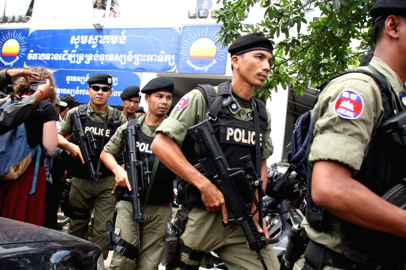 PHNOM PENH, May 26, 2016 - Cambodian police briefly surround the headquarters of the main opposition Cambodia National Rescue Party (CNRP) in Phnom Penh, Cambodia, May 26, 2016. Cambodian security ...