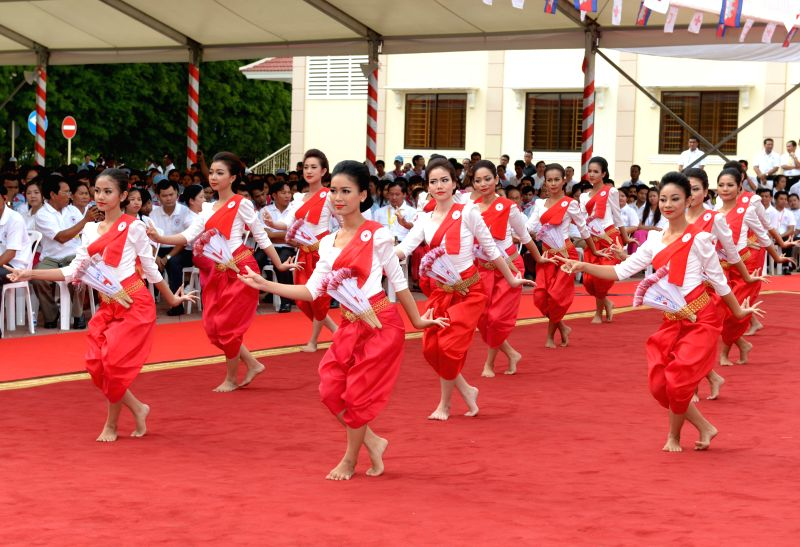Cambodian artists perform during a celebration of the 151st anniversary of the World Red Cross and Red Crescent Day in Phnom Penh, Cambodia, May 8, 2014. Cambodia .
