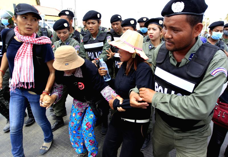PHNOM PENH, May 9, 2016 - Black-dressed protesters are blocked on their way to rally in front of the Prey Sar prison on the southwestern outskirts of Phnom Penh, Cambodia, May 9, 2016. The Cambodian ...
