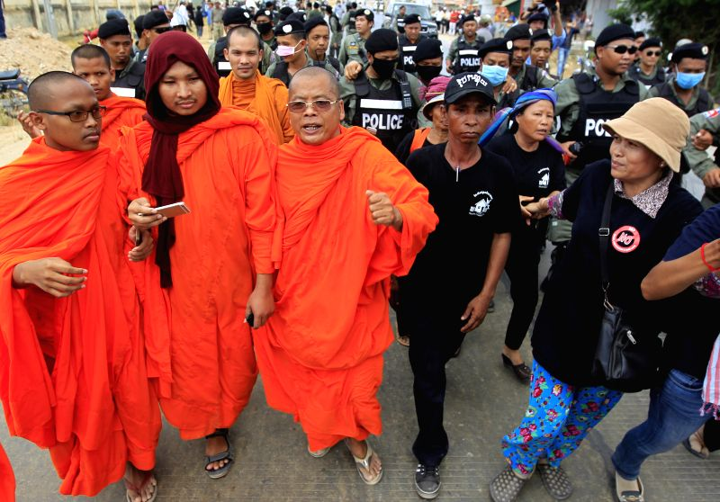 PHNOM PENH, May 9, 2016 - Black-dressed protesters, along with protesting monks, are blocked on their way to rally in front of the Prey Sar prison on the southwestern outskirts of Phnom Penh, ...