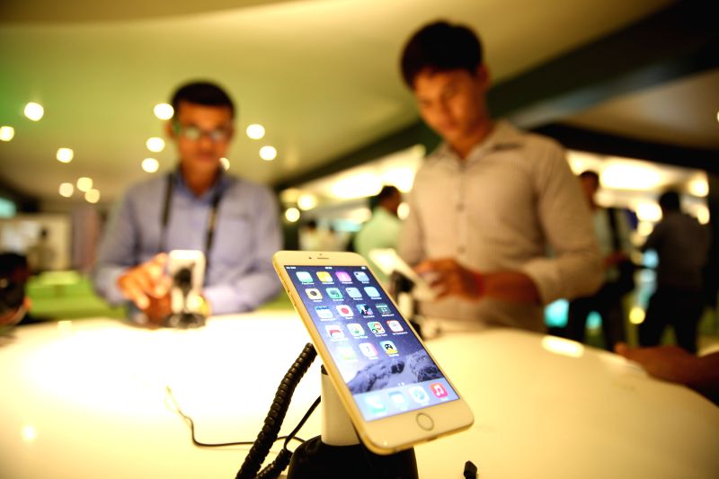 Phnom Penh: People try the iPhone 6 at Smart Store in Phnom Penh, Cambodia, Nov. 21, 2014. Around 400 Cambodian people, mostly youths, queued to buy iPhone 6 or iPhone 6 Plus at a local telecom firm,