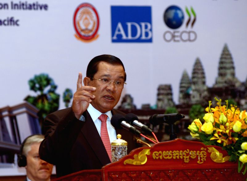 Cambodian Prime Minister Hun Sen speaks during the 8th regional conference on fighting corruption in Phnom Penh, Cambodia, Sept. 3, 2014. Hun Sen said Wednesday . - Hun Sen