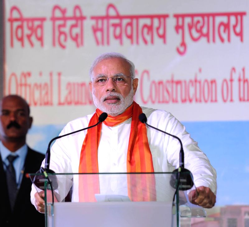 Prime Minister Narendra Modi addresses at the Bhawan Nirman Aarambh, World Hindi Secretariat Building site, at Phoenix, in Mauritius on March 12 2015. - Narendra Modi