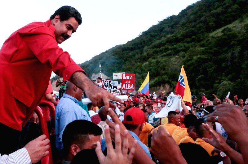 Photo provided by Venezuela's Presidency shows Venezuelan President Nicolas Maduro (L) taking part in the opening ceremony of the Rio Grande traffic junction, in ...