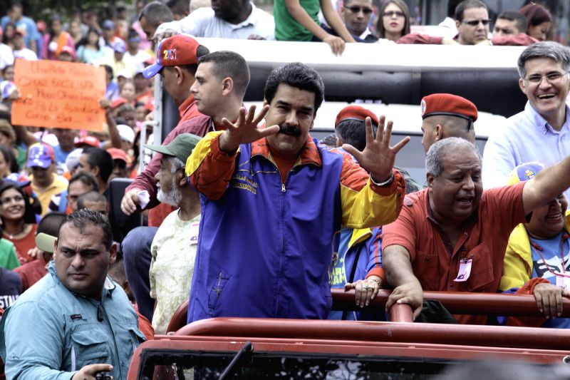 Photo provided by Venezuela's Presidency shows Venezuelan President Nicolas Maduro (C Front) taking part in a running campaign of candidates of the United Socialist ...
